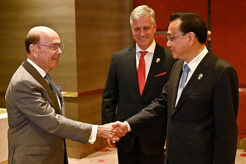 (From left) US Commerce Secretary Wilbur Ross, US National Security Adviser Robert O'Brien and Chinese Premier Li Keqiang at a bilateral meeting on the sidelines of the Asean Summit in Bangkok on Sunday. PHOTO: REUTERS