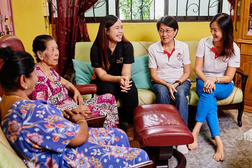 AIC officer Ms Hidayah (centre) who is part of the Community Networks for Seniors team, together with Silver Generation Ambassadors Jessie Tay and Fion Soh (right), connect caregivers like Madam Saraswathi to Community Care support. PHOTO: TED CHEN