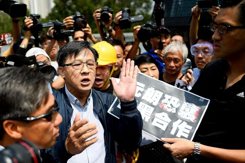 A photo taken on Aug 12, 2019 shows pro-Beijing Hong Kong lawmaker Junius Ho (centre left) and pro-democracy lawmakers arguing in Hong Kong. On Nov 6, Mr Ho, his assistant and an alleged assailant were injured in Tuen Mun.