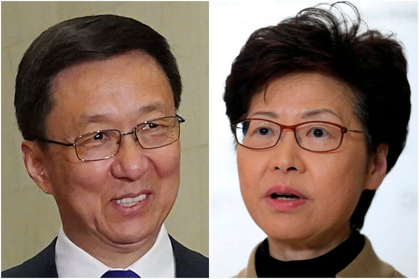 """Mr Han Zheng (left), at an official meeting with Mrs Carrie Lam in Beijing, said that anti-government protests were damaging the """"one country, two systems"""" framework."""