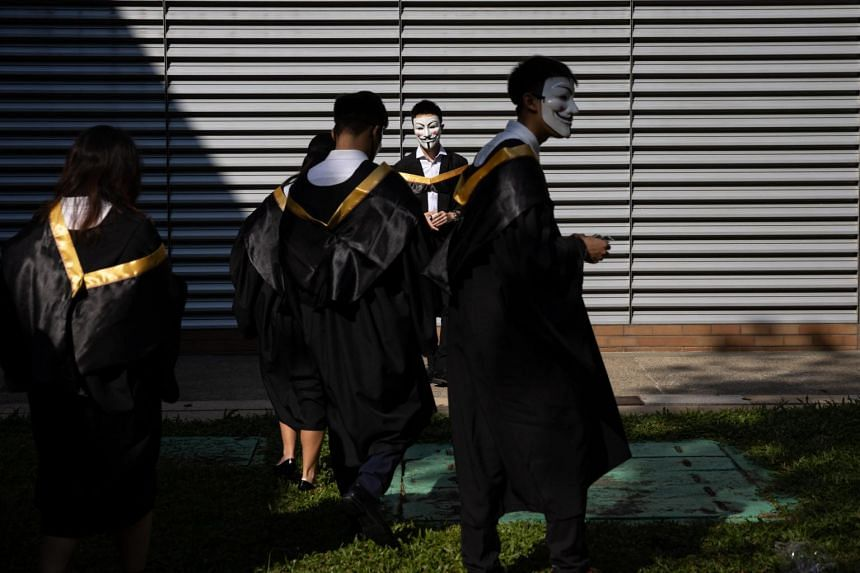 A group of Hong Kong Polytechnic University students wear Guy Fawkes masks during an anti-government protest on their graduation day, on Nov 5, 2019.