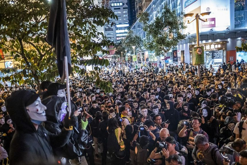 Demonstrators wearing Guy Fawkes masks gather during a protest at Urban Council Centenary Garden in the Tsim Sha Tsui district of Hong Kong, on Nov 5, 2019.