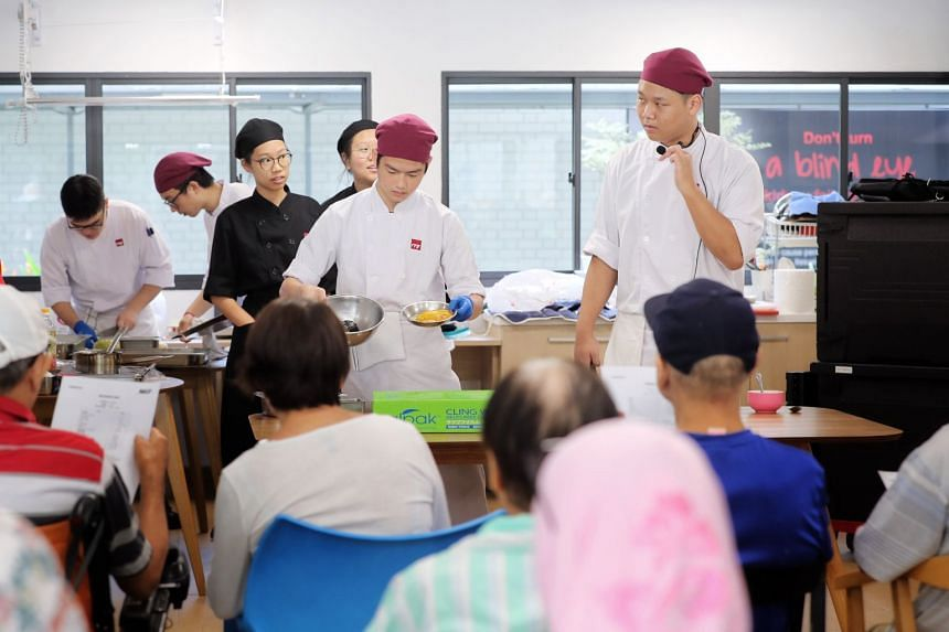 ITE College West students conduct a live cooking demonstration for National Kidney Foundation dialysis patients at the NKF Integrated Renal Centre on Nov 6, 2019.