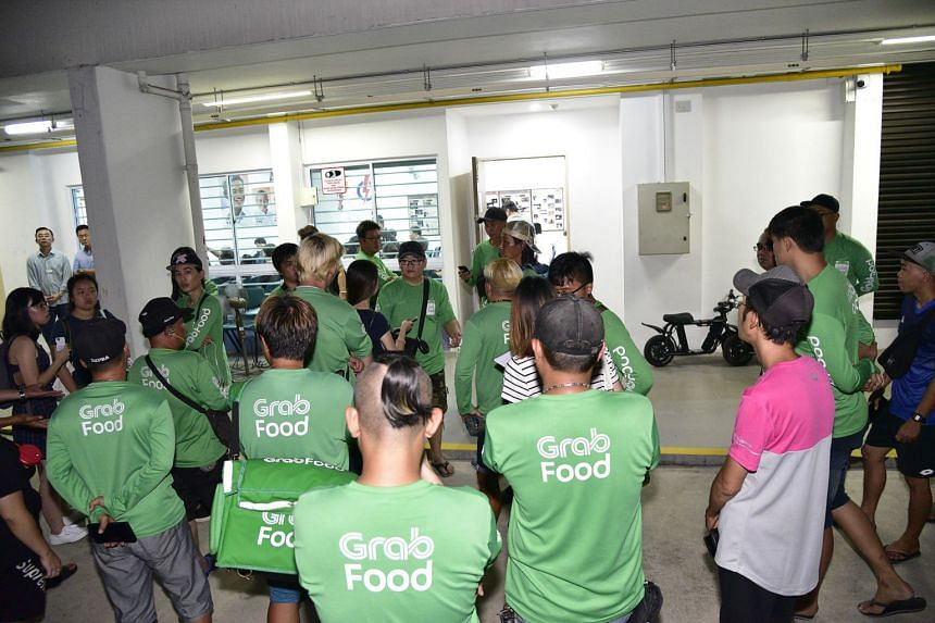 More than 50 Grab Food delivery riders attended a Meet-the-People session at PM Lee Hsien Loong's Teck Ghee ward on Nov 6, 2019.