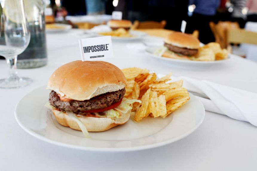 In a file photo taken on Oct 6, 2016, the completed plant-based hamburger is displayed during a media tour of Impossible Foods labs and processing plant in Redwood City, California.