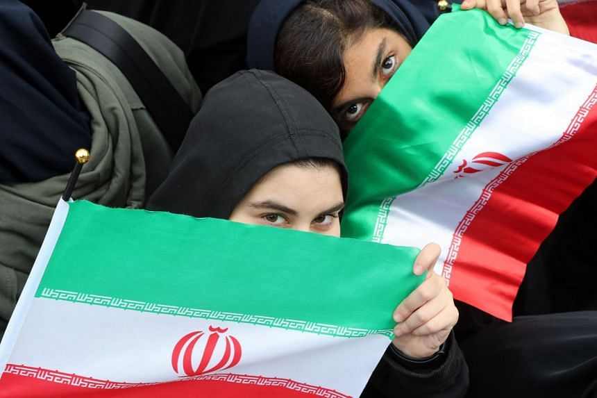Iranian women take part in an anti-US demonstration in Teheran marking the 40th anniversary of US Embassy takeover.