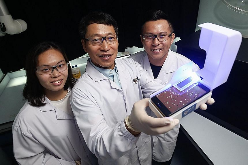 Assistant Professor Bae Sung-woo, flanked by master's student Elaine Chiang and doctoral student Thio Si Kuan, developed an easy-to-use device costing less than $300. Conventional methods can cost up to $100,000.