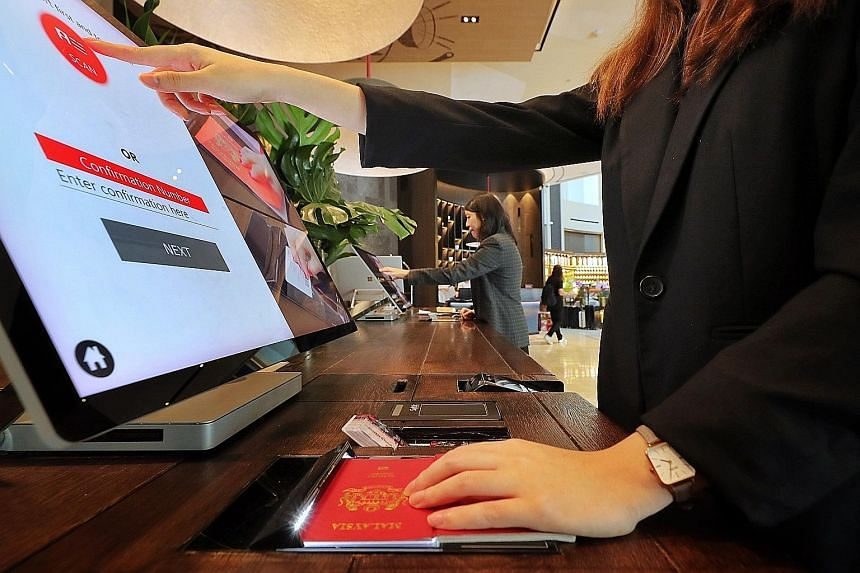 The E-Visitor Authentication system is being piloted at three hotels in Singapore, including Swissotel The Stamford (left).