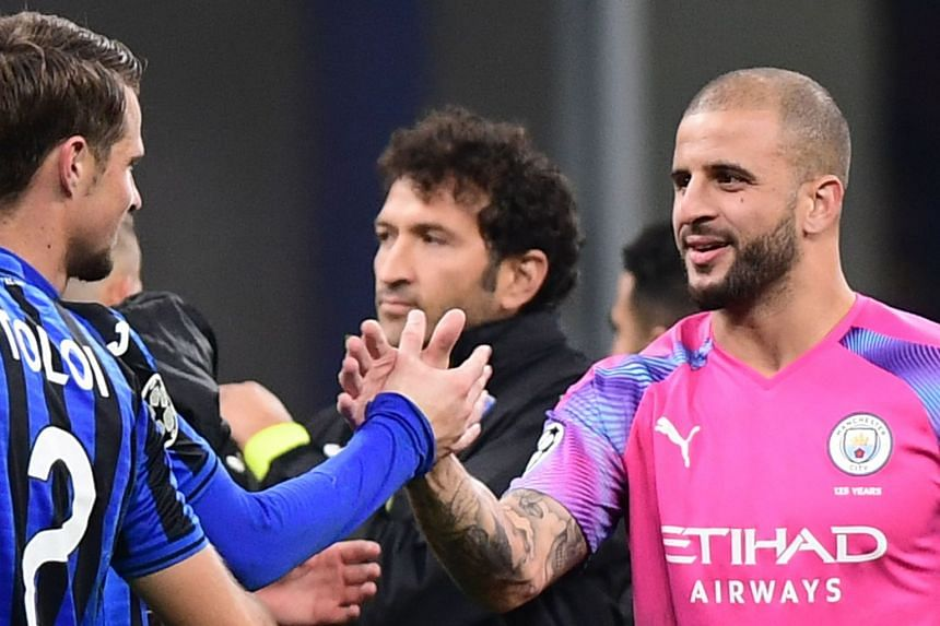 City's Kyle Walker (right) taps hands with Atalanta's Hans Hateboer at the end of the match.