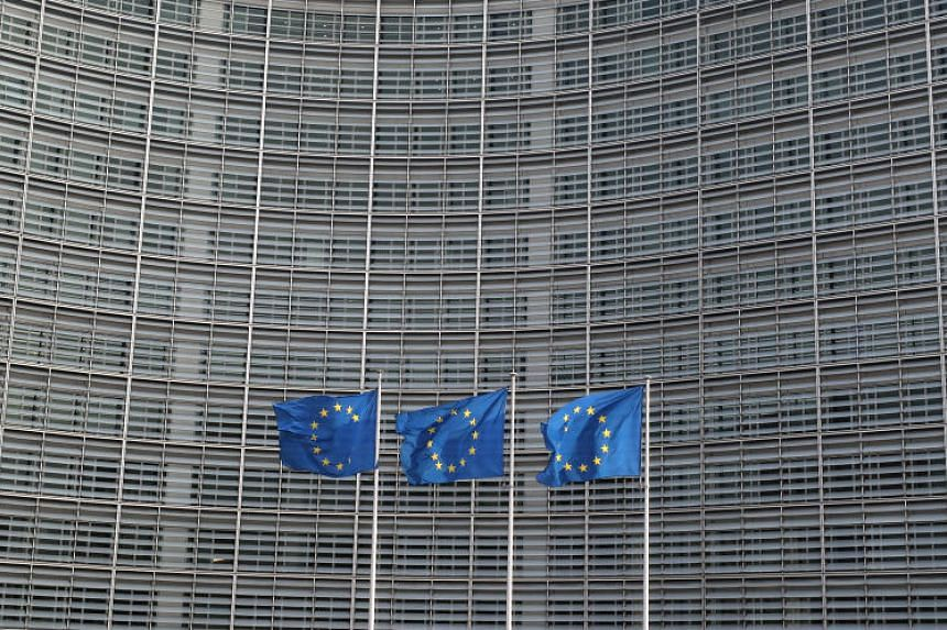 European Union flags fly outside the European Commission headquarters in Brussels, Belgium on April 10, 2019.