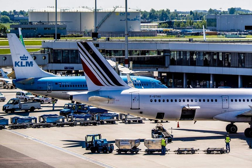 Schiphol airport: Dutch military police investigating 'suspicious situation' on plane