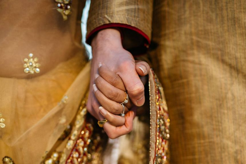 """File photo of a couple holding hands. The incident in India is the latest in a string of so-called """"honour killings"""" which are rampant in rural pockets of the country."""