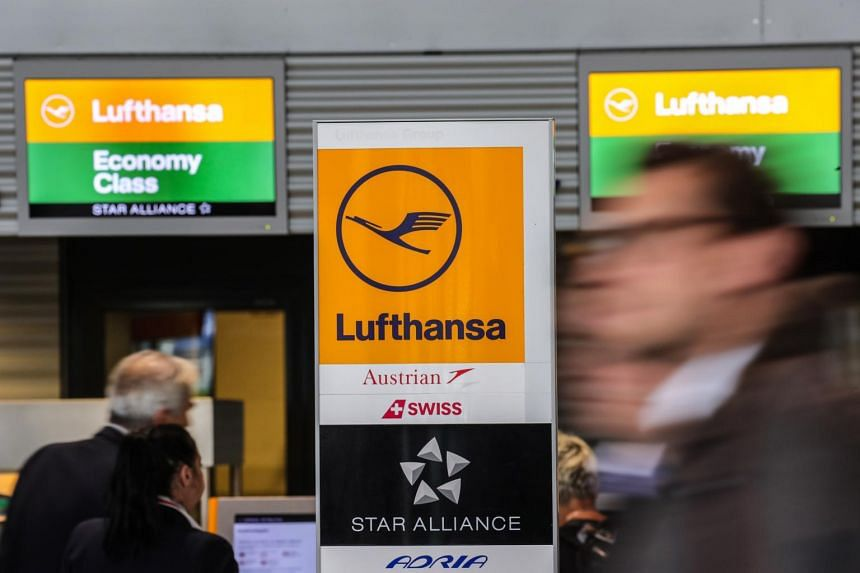Passengers check their boarding passes at a Lufthansa self service in Terminal 1 of Fraport international airport in Frankfurt am Main, Germany, on Nov 6, 2019.