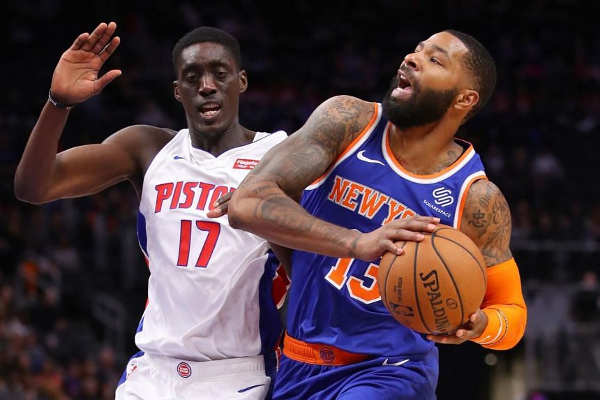 Tony Snell of the Detroit Pistons and Marcus Morris of the New York Knicks during a game in Detroit, Michigan, on Nov 6, 2019.