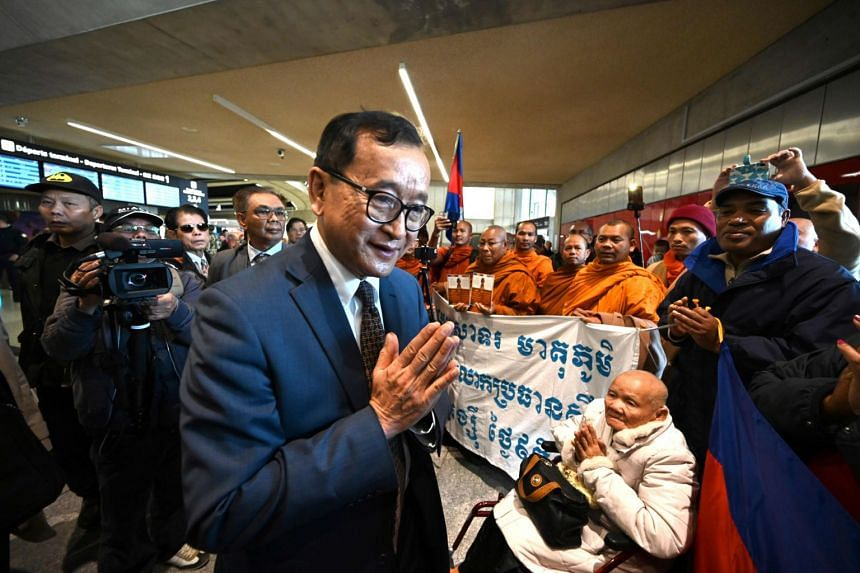 Cambodian opponent-in-exile and leader of the Cambodia National Rescue Party (CNRP) Sam Rainsy with supporters at the Roissy-Charles de Gaulle airport, north of Paris, on Nov 7, 2019