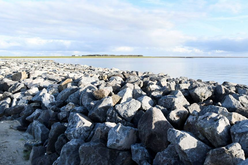 Reinforcement of the Houtribdijk using extra stone dikes to break waves, as the low-lying Netherlands tries to protect itself from the expected rise of sea levels due to climate change in Lelystad on Nov 6, 2019.