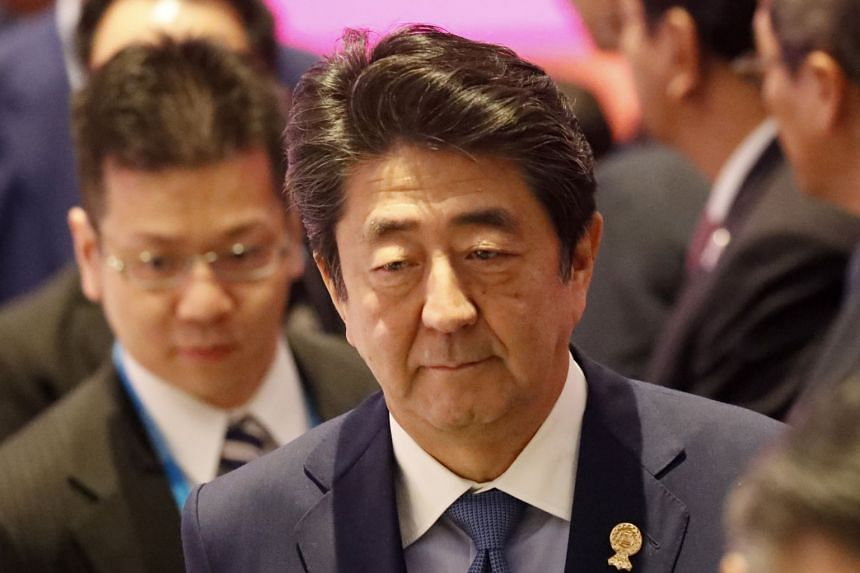 Japanese Prime Minister Shinzo Abe leaves from the stage during the 22nd Asean-Japan Summit of the 35th Asean Summit at IMPACT Muang Thong Thani, Thailand on Nov 4, 2019.