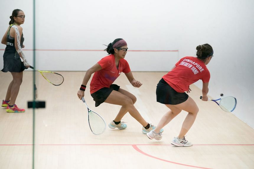 Singapore's (centre) Mao Shihui and Sherilyn Yang in action at the SEA Games, on Aug 24, 2017.