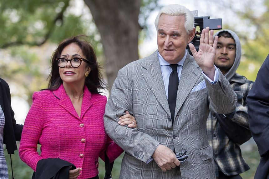 Stone arrives with his wife, Nydia, for his trial in Washington, Nov 7, 2019.