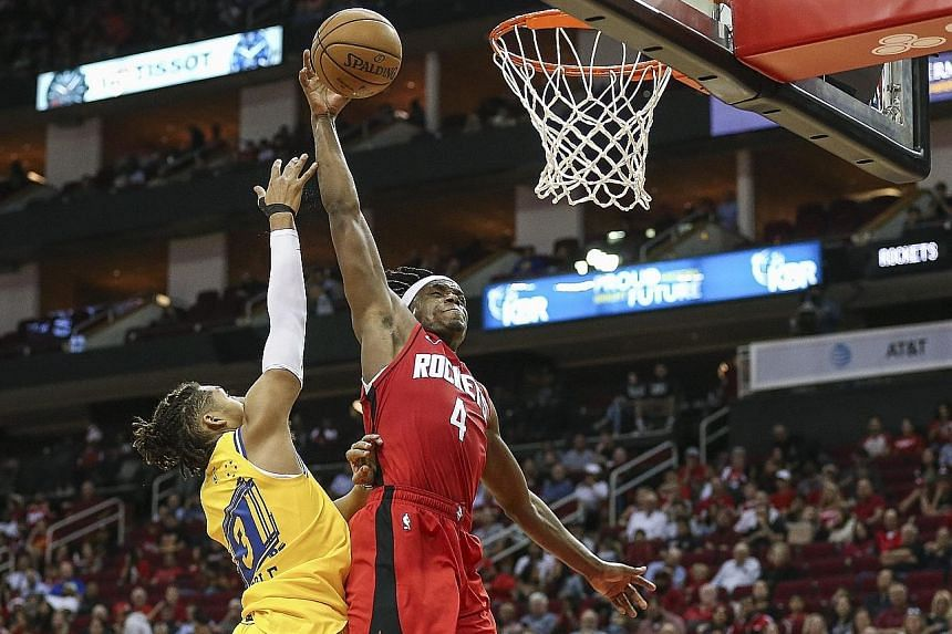 Houston forward Danuel House Jr attempting to score against Golden State's rookie guard Jordan Poole during their NBA game at the Toyota Centre on Wednesday night. The Rockets won 129-112 to improve to 5-3, while the Warriors dropped to 2-6. PHOTO: R