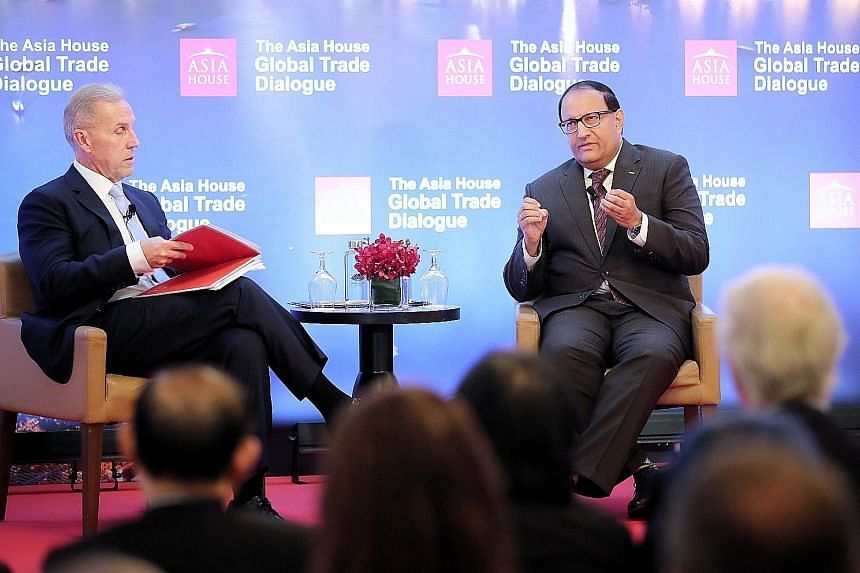 Minister-in-charge of Trade Relations S. Iswaran (right) said at yesterday's Asia House Global Trade Dialogue moderated by Asia House CEO Michael Lawrence that it is important to keep up the engagement with India. ST PHOTO: GAVIN FOO
