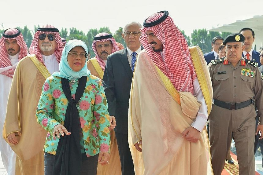 President Halimah Yacob and her husband, Mr Mohamed Abdullah Alhabshee, being welcomed by deputy governor of Mecca, Prince Badr Bin Sultan Bin Abdulaziz Al Saud, at King Abdulaziz International Airport in Jeddah yesterday.