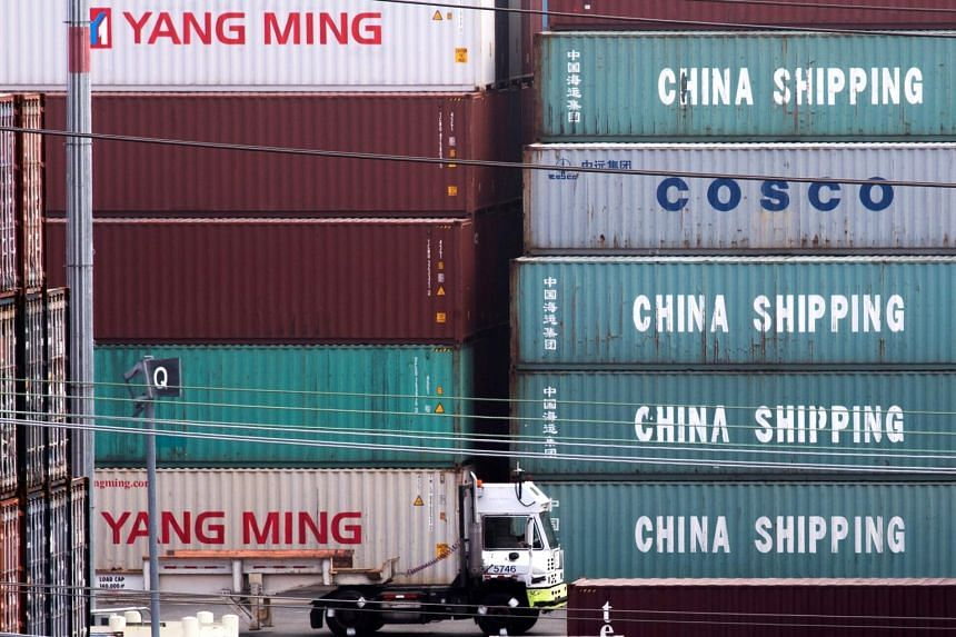 China Shipping containers are seen at the Port of Los Angeles on Sept 1, 2019. If a pact is reached, the Trump administration has committed to cutting some tariffs.