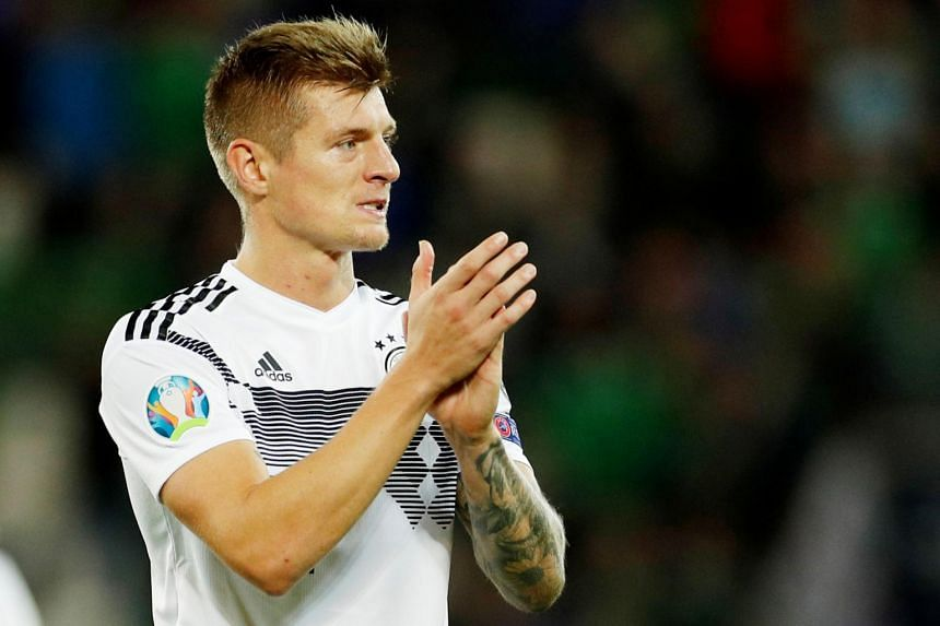 In a photo taken on Sept 9, Germany's Toni Kroos applauds the fans after the Euro 2020 qualifier Group C match between Northern Ireland and Germany at Windsor Park, Belfast, Britain.
