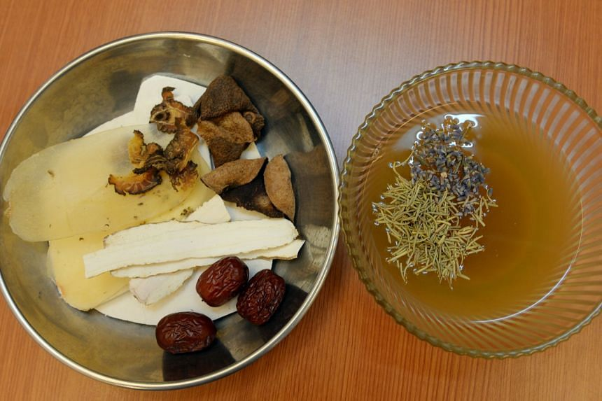 Herbal tea prepared by a traditional Chinese medicine practitioner.
