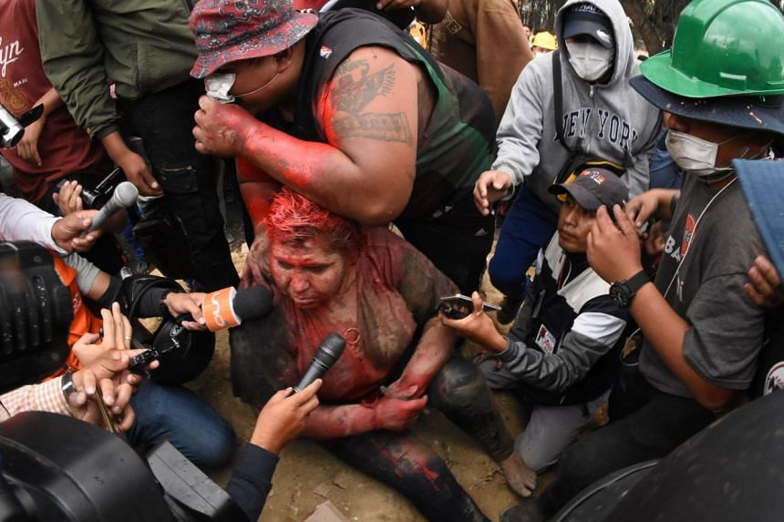 Ms Patricia Arce speaks to the press as she is humiliated by a mob of opposition supporters in Vindo, Bolivia, on Nov 6, 2019.