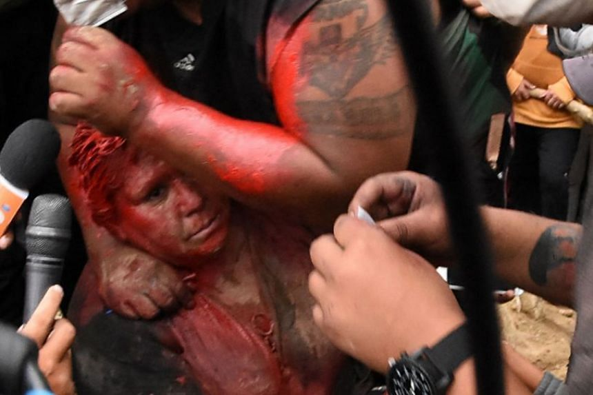Ms Patricia Arce was seen on the ground, her hair cut, and covered in red paint during the humiliating attack in Vindo, Bolivia, on Nov 6, 2019.
