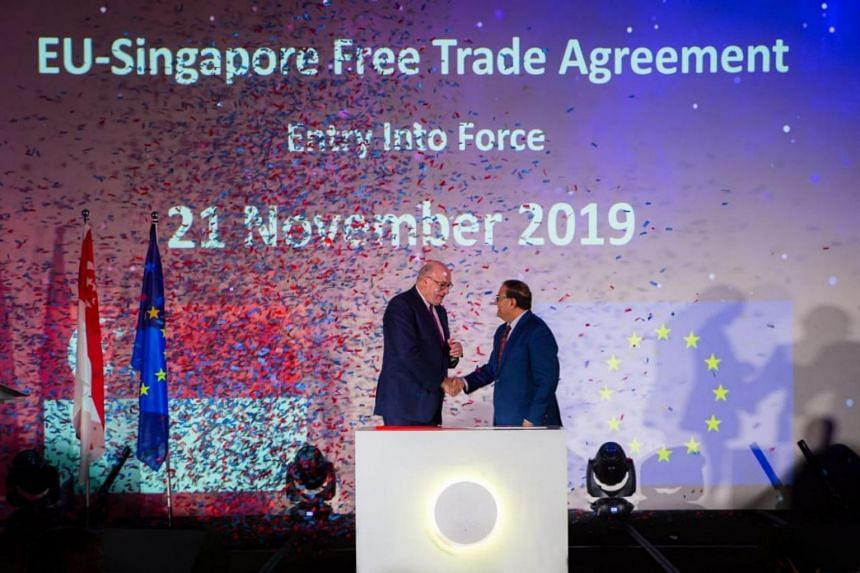 Minister-in-charge of Trade Relations S. Iswaran (right) announced the FTA with EU trade commissioner-designate Phil Hogan at a gala dinner on Nov 8, 2019.