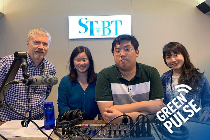 ST's climate editor David Fogarty (far left) and environment correspondent Audrey Tan (far right) chat with climate change observers Melissa Low and Eric Bea, who are researchers from the National University of Singapore, on roadblocks that have em