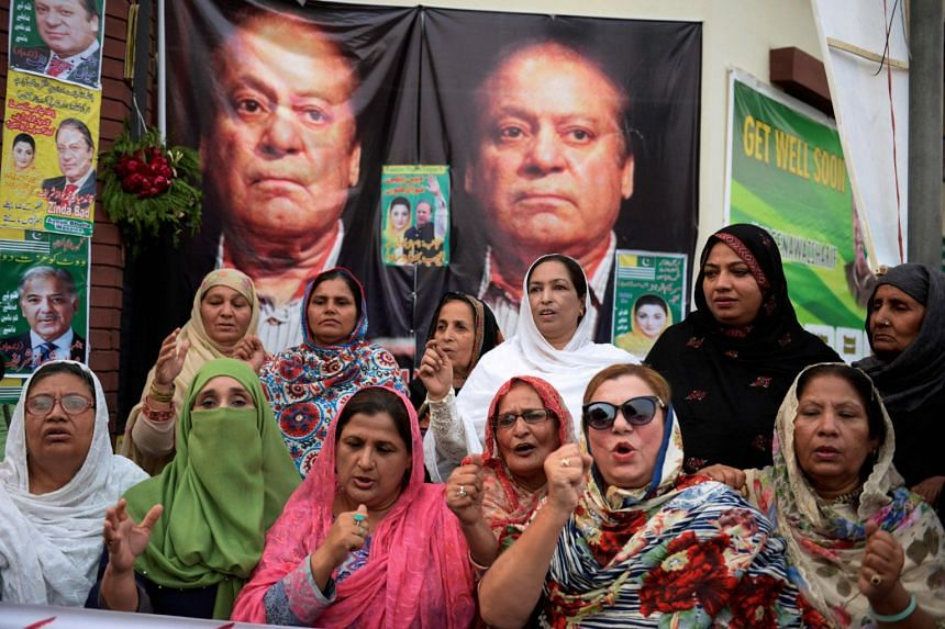 Sharif supporters pray outside a hospital in Lahore on Oct 26, 2019.