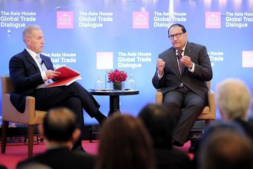 Minister for Communications and Information S. Iswaran (right) at the Asia House Global Trade Dialogue at Mandarin Oriental hotel on Nov 7, 2019.