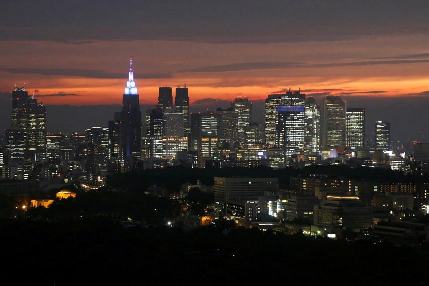 High-rise buildings are seen at the Shinjuku business district during sunset in Tokyo, Japan on May 31, 2018. Japanese policymakers have been under pressure to fend off heightening overseas risks with a diminishing toolkit.