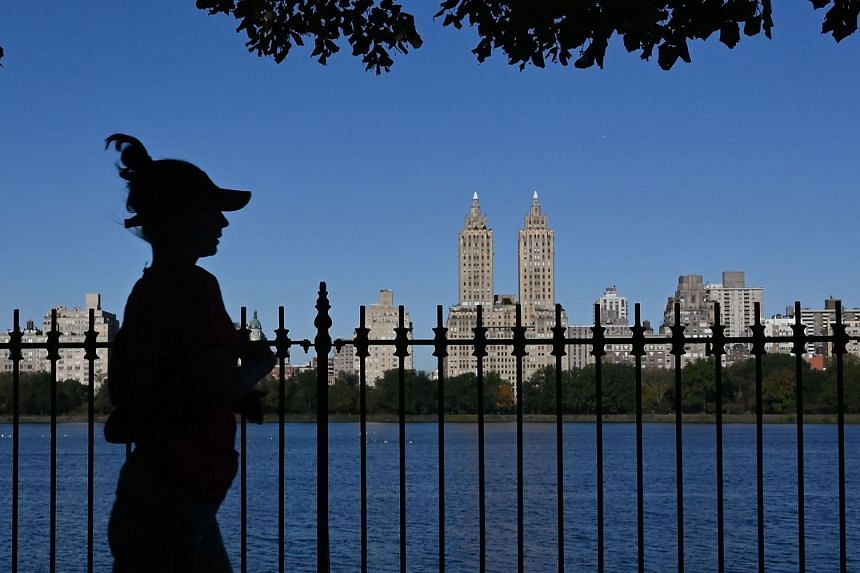 A jogger runs in Central Park in New York.