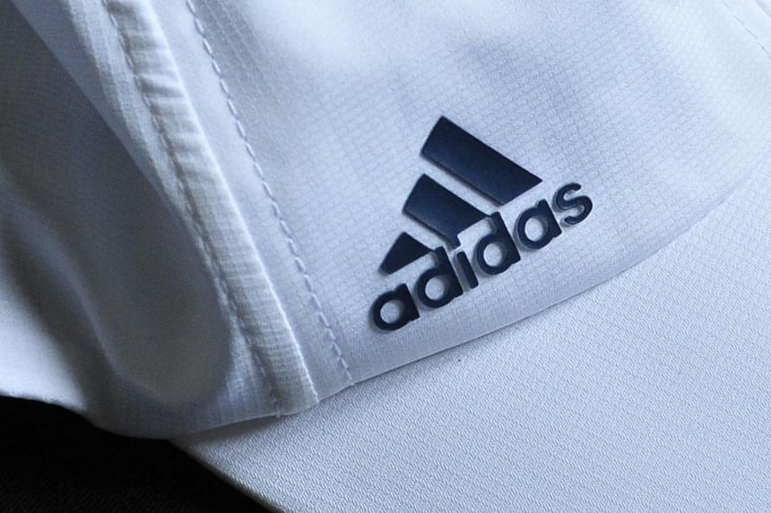 The judge found that Lutong Enterprise Corp's mark of three sloping lines in an inverted pyramid with a circle at one end is visually similar to Adidas' mark, and people may be confused by the two marks.