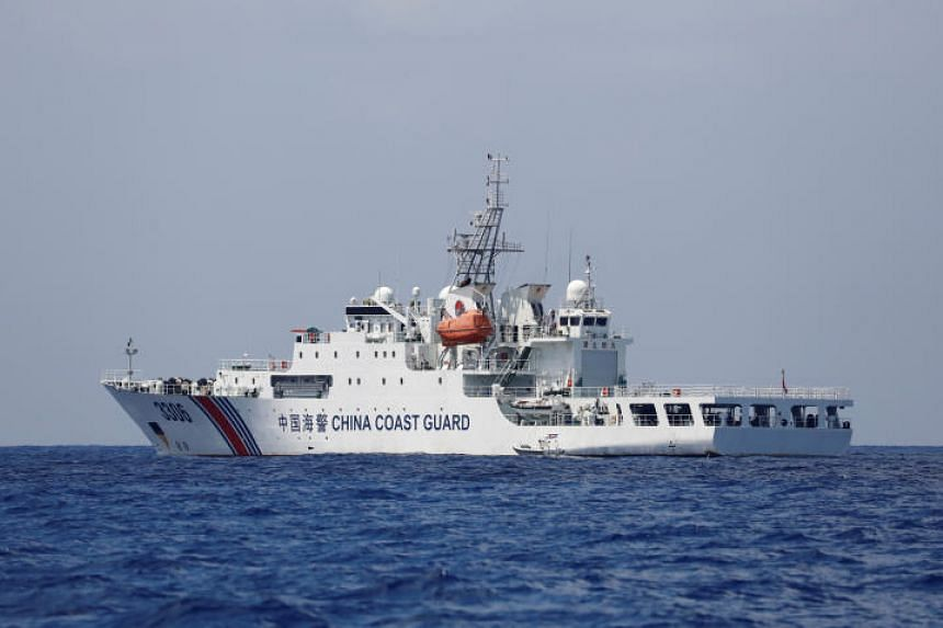 In a photo from April 6, 2017, a China Coast Guard vessel patrols at the disputed Scarborough Shoal.