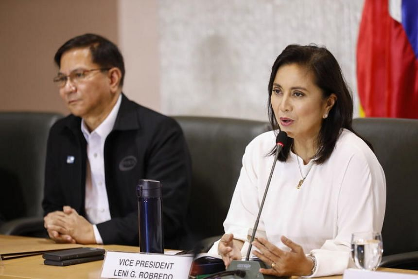 Philippine Vice-President Leni Robredo (right) speaks while Philippine Drug Enforcement Agency Director General Aaron Aquino (left) looks on during a meeting as co-chairpersons of the Inter-Agency Committee on Anti-Illegal Drugs in Quezon City, Phili