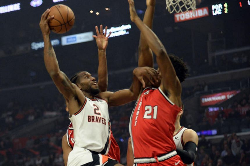 Los Angeles Clippers forward Kawhi Leonard (2) moves to the basket against Portland Trail Blazers center Hassan Whiteside (21) during the first half at Staples Center.