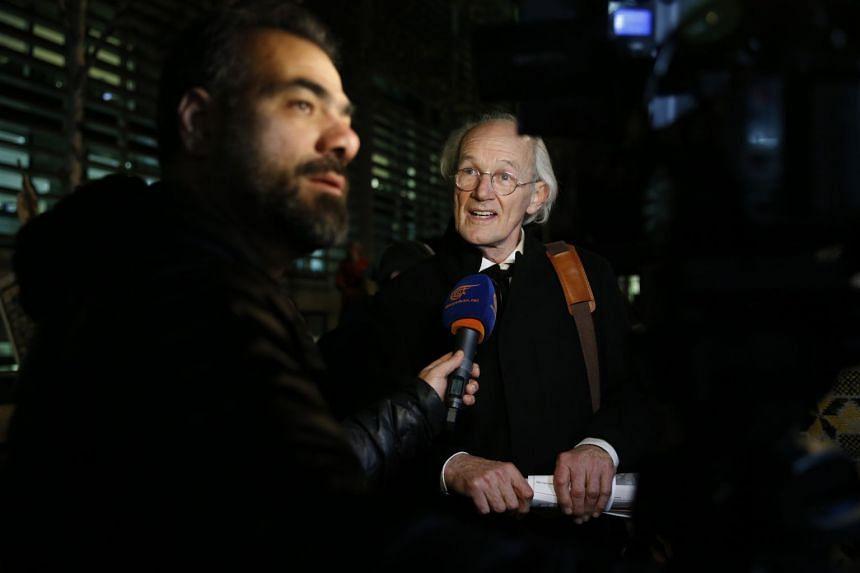 John Shipton, father of Julian Assange, is interviewed by a journalist in London.