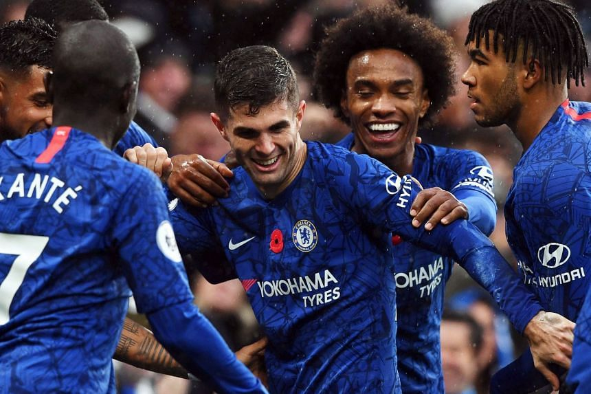Chelsea's Christian Pulisic (centre) celebrates with team mates after scoring the 2-0 lead.