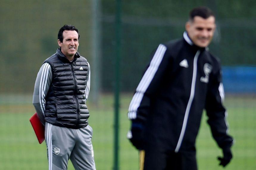 Arsenal manager Unai Emery and Granit Xhaka during training.