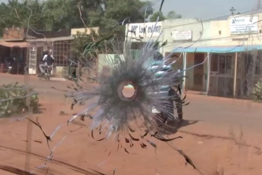 A bullet hole in a bus window is seen after it was attacked near Fada N'gourma, Burkina Faso.