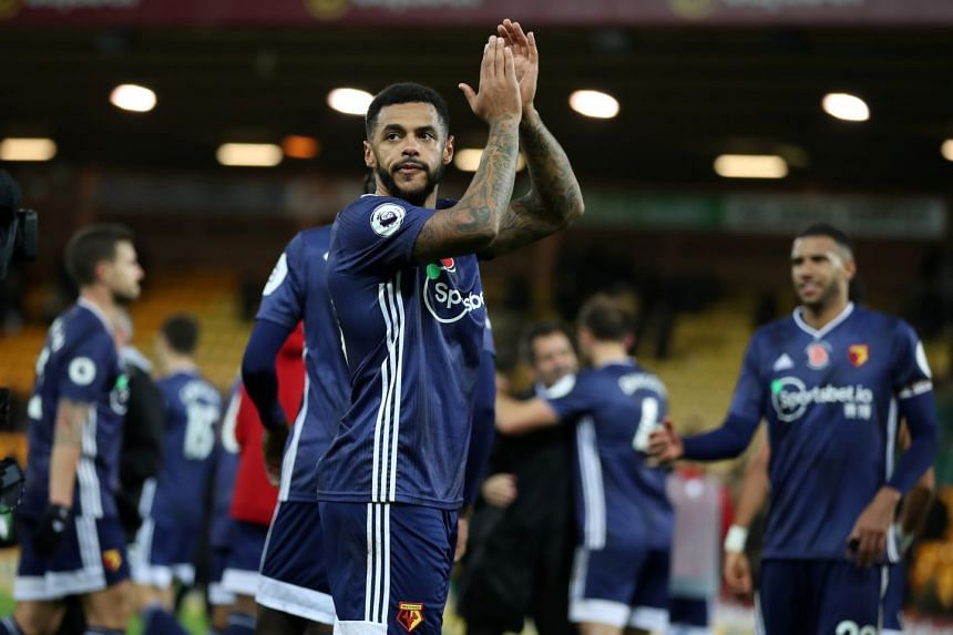 Watford's Andre Gray applauds the fans after the match.