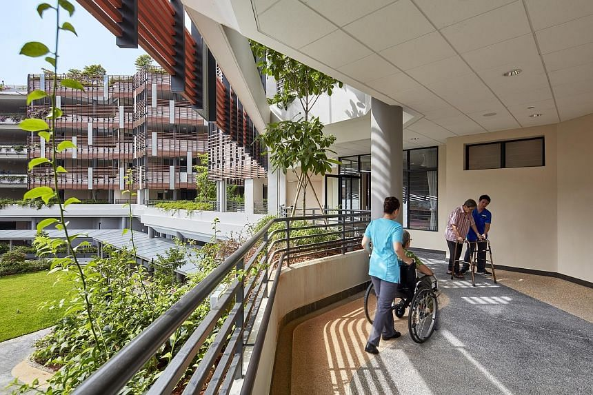 A chapel (above) is the heart of St Joseph's Home, which now offers wider corridors that also look out to greenery (left). Designed by Singapore-based architecture practice SAA Architects, St Joseph's Home's redevelopment was completed in end-2016.