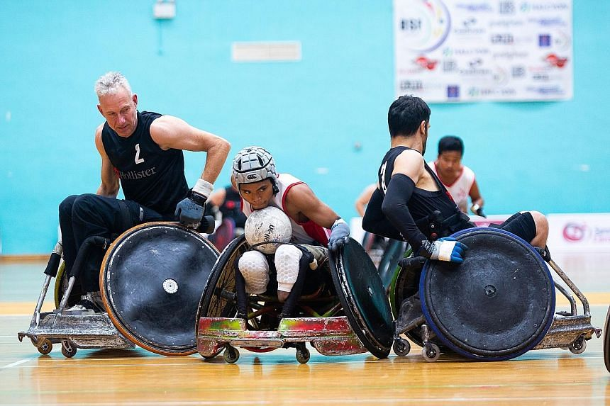 Team Indonesia's Mashuri fending off the European team on Thursday during the three-day Halcyon Agri International Wheelchair Rugby Tournament Super Series in Singapore. It ends today with two semi-finals at Toa Payoh Sports Hall and the medal matches at
