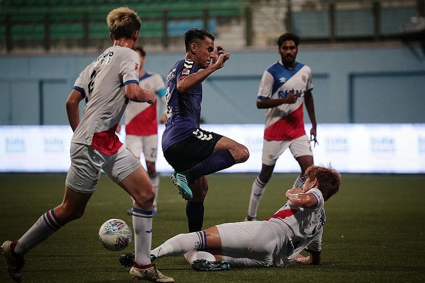 Warriors FC (in white) were losing finalists to Tampines Rovers in the Singapore Cup last Saturday. The club have been charged with offences against the Employment Act for owing over $350,000 in salaries.