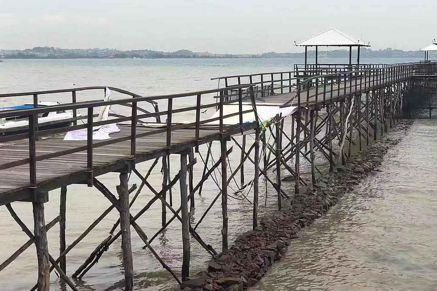 A section of the wooden structure collapsed when about 30 Mendaki staff were preparing to take a group photo on this bridge at Montigo Resorts Nongsa in Batam on Thursday. They reportedly heard a cracking sound, before most of them fell about 3m into